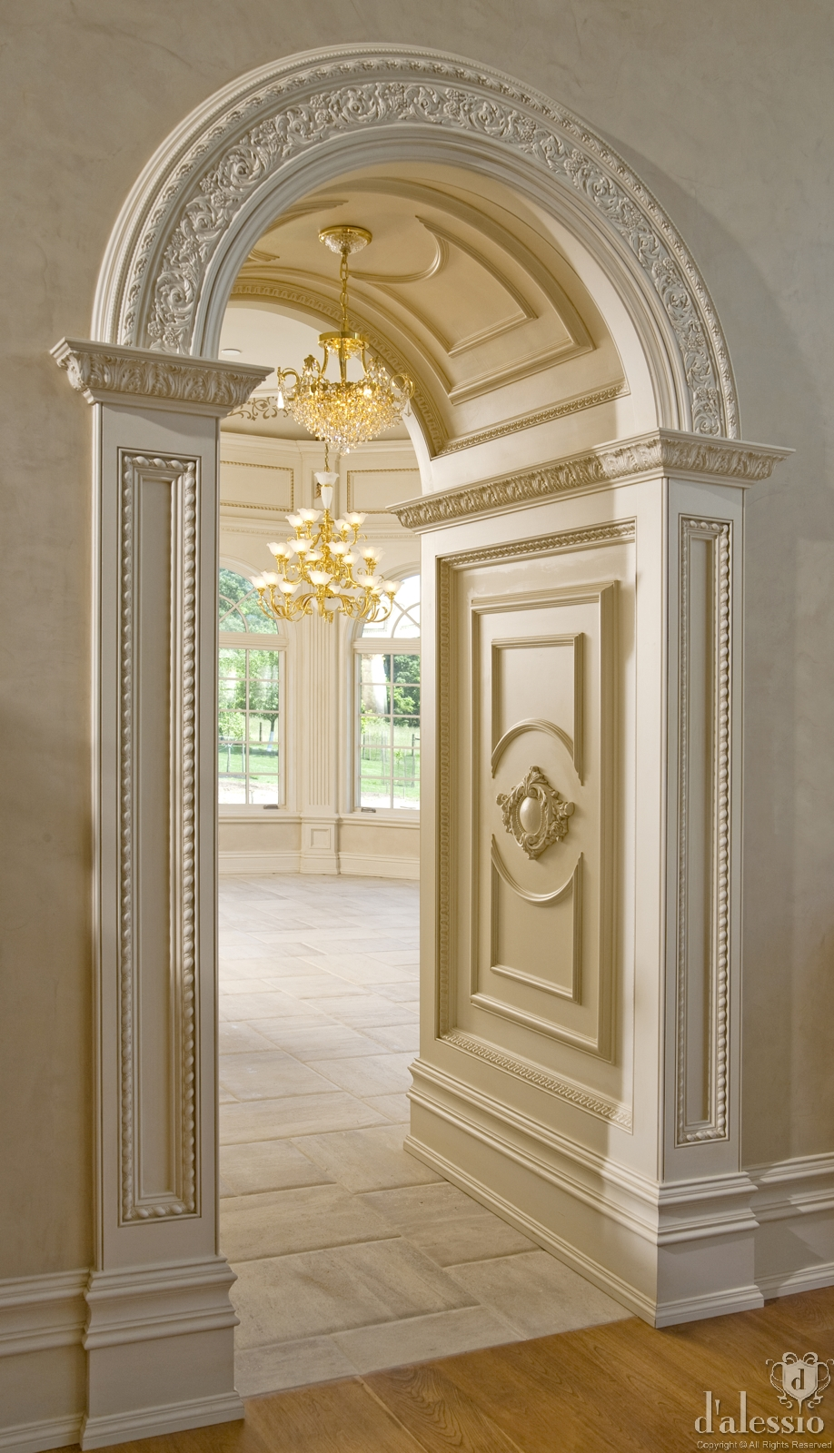 arched doorway with beautiful millwork halls entry ways